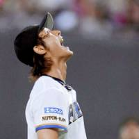 Japan's ace: National team manager Senichi Hoshino is hoping Yu Darvish can have the same kind of impact during the Olympic tournament that he's had with the Hokkaido Nippon Ham Fighters. | KYODO PHOTO
