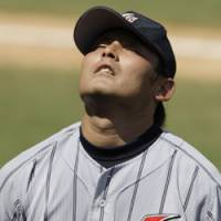 Over and out: Reliever Kenshin Kawakami leaves the mound after giving up four runs in Japan's 8-4 bronze- medal game loss to the U.S. on Saturday. | AP PHOTO