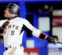 Milestone: Yomiuri Giants slugger Alex Ramirez hits his 250th career homer in the third inning during Wednesday's game against the Yokohama BayStars at Yokohama Stadium. The Giants won 6-2. | KYODO PHOTO