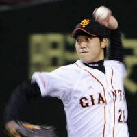 Strong performance: Giants southpaw Tetsuya Utsumi tosses eight innings of one-run ball, earning his first win since Aug. 26. Yomiuri beat Hanshin 9-1 on Saturday at Tokyo Dome. | KYODO PHOTO
