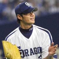 Dragon punch: Chunichi's Taiwanese southpaw Chen Wei-yin gets the first shutout complete game of his NPB career against Tokyo Yakult at Nagoya Dome on Monday. The Dragons cruised past the Swallows 7-0. | KYODO PHOTO