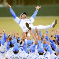 Party time: Seibu player toss first-year manager Hisanobu Watanabe into the air after their victory over the Fighters in Game 5 of the second stage of the Pacific League Climax Series on Wednesday. | KYODO PHOTO