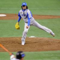Battle started: Seibu Lions starting lefty Kazuyuki Hoashi tosses a pitch against the SK Wyverns on the first day of the Asia Series at Tokyo Dome. The South Korean club edged Seibu 4-3.