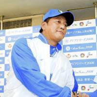 Fine job: Seibu Lions manager Hisanobu Watanabe (left) congratulates pitcher Takayuki Kishi after the team's 2-1 victory over the Uni-President 7-Eleven Lions in the Asia Series on Friday at Tokyo Dome. Kishi pitched eight innings of one-run ball and struck out 10 batters. | KYODO PHOTO