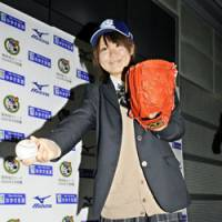 A league of her own: Eri Yoshida's proficiency with the knuckleball has her on track to become Japan's first female professional baseball player. | KYODO PHOTO