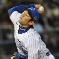 Ray of hope: Daisuke Miura's decision to remain with the Yokohama BayStars and some offseason moves have boosted the club's hopes for the 2009 season. | AP PHOTO