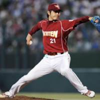 Key component: Hisashi Iwakuma will pitch for Japan when it defends its title at the World Baseball Classic in March. | AP PHOTO