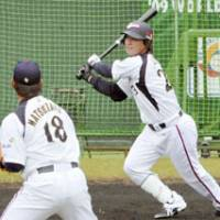 National pride: Tokyo Yakult Swallows outfielder Norichika Aoki hits a home run off Boston Red Sox hurler Daisuke Matsuzaka in simultated game during Japan's World Baseball Classic training camp at Sun Marine Stadium in Miyazaki on Wednesday. | KYODO PHOTO