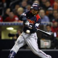Hit machine: Norichika Aoki rips an RBI single in the fifth inning against Cuba on Wednesday night in a second-round game at the World Baseball Classic in San Diego. Japan won 5-0. | AP PHOTO