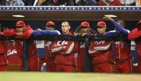 Early exit: Cuban players line the dugout as they watch Japan close out a 5-0 victory that eliminated the historically strong team from the World Baseball Classic on Wednesday. | AP PHOTO