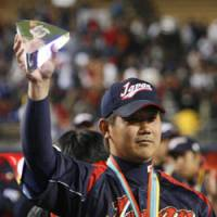 MVP again: Daisuke Matsuzaka shows off his trophy after being voted the World Baseball Classic's Most Valuable Player on Monday. Matsuzaka also won the honor in 2006. | AP PHOTO