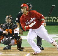 Play ball!: Hiroshima Carp first baseman Kenta Kurihara hits a run-scoring single to center in the first inning off Yomiuri Giants starter Seth Greisinger at Tokyo Dome on Friday in the teams' Nippon Professional Baseball season opener. The Carp won 6-3. | KYODO PHOTO