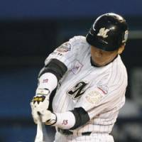 Nice focus: Chiba Lotte designated hitter Tasuku Hashimoto smacks a two-run double in the first inning against the Orix Buffaloes on Tuesday. The Buffaloes beat the Marines 4-3 in 10 innings. | KYODO PHOTO