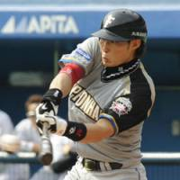 Holiday hit: Hokkaido Nippon Ham's Yoshio Itoi hits a two-run single during the Fighters' 10-7 win over the Chiba Lotte Marines on Monday. | KYODO PHOTO