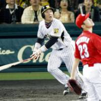 See ya!: Hanshin slugger Tomoaki Kanemoto hits a 'sayonara' homer in the bottom of the ninth inning to lead the Tigers to a 1-0 victory over the Hiroshima Carp on Tuesday at Koshien Stadium. | KYODO PHOTO