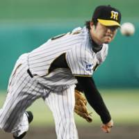 Eye of the Tiger: Hanshin's Yuya Ando tosses a pitch during the Tigers' 7-1 win over the Carp on Thursday. | KYODO PHOTO