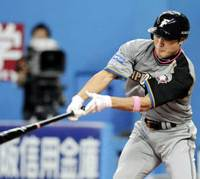 Chipping in: The Fighters' Kensuke Tanaka delivers an RBI hit in the fourth inning against host Orix on Friday. Hokkaido Nippon Ham defeated the Buffaloes 4-2. | KYODO PHOTO