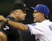 Making a point: Current Kansas City Royals skipper Trey Hillman, seen arguing a call in a July 2008 game before being ejected, enjoyed his five seasons with the Fighters but wanted his children to return to the United States to attend school after the 2007 season.