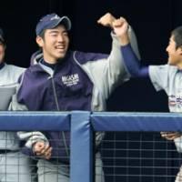 Next big thing: Hanamaki Higashi High School pitcher Yusei Kikuchi enjoys his moment in the spotlight on Monday. | KYODO PHOTO