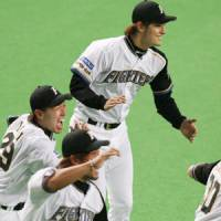 Dynamic duo: The Hokkaido Nippon Ham Fighters have the PL's top offense but will need big contributions from pitchers Yu Darvish (top) and Tomoya Yagi (center) if they hope to win the Japan Series. | KYODO PHOTO