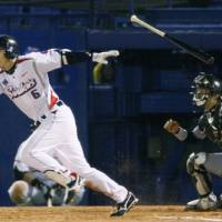 Timely hit: Shinya Miyamoto drives in an insurance run in the seventh inning of the Swallows' 3-1 win over the Tigers on Friday at Jingu Stadium. | KYODO PHOTO