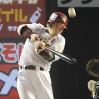 Timely hit: Tohoku Rakuten's Daisuke Kusano hits an RBI double in the sixth inning against the Fukuoka Softbank Hawks in Game 1 of the first stage of the Pacific League Climax Series on Friday. | KYODO PHOTO