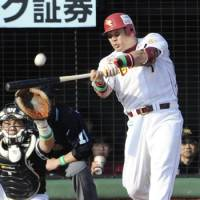 Bird of prey: Tohoku Rakuten's Takeshi Yamasaki hits a three-run homer to help the Golden Eagles sweep the Hawks in the first stage of the Pacific League Climax Series on Saturday. | KYODO PHOTO
