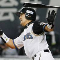 Big at-bat: Fighters catcher Shinji Takahashi smacks a two-run single in the seventh inning to lead the hosts to a 3-1 victory over the Eagles in Game 2 of the Pacific League Climax Series second stage at Sapporo Dome. | KYODO PHOTO
