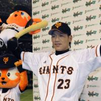 Friday's hero: The Giants' Ryota Wakiya enjoys the spotlight after Game 3 of the Central League Climax Series second stage at Tokyo Dome. Yomiuri defeated Chunichi 5-4. | KYODO PHOTO