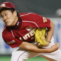 Big lift: Eagles hurler Masahiro Tanaka earns a complete game win against the Fighters on Friday in Game 3 of the PL Climax Series second stage at Sapporo Dome. Tohoku Rakuten defeated Hokkaido Nippon Ham 3-2. | KYODO PHOTO