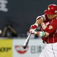 On the money: The Eagles' Daisuke Kusano rips a two-run single in the fourth inning against the Fighters on Friday. | KYODO PHOTO