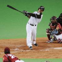 Power supply: Fighters slugger Terrmel Sledge crushes a three-run homer in the eighth inning off Eagles pitcher Hisashi Iwakuma in Game 4 of the Pacific League Climax Series second stage. Hokkaido Nippon Ham beat Tohoku Rakuten 9-4 and advanced to the Japan Series.   KYODO PHOTO