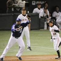 Big things come in small packages: Tetsuya Matsumoto (right) has played his way into a starting role with the Yomiuri Giants this season. | KYODO PHOTO