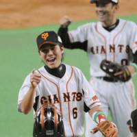 Happy time: The Yomiuri Giants congratulate one another after their 4-3 win over the Hokkaido Nippon Ham Fighters in Game 1 of the Japan Series.