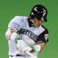 Fighting spirit: Atsunori Inaba hits a homer in Game 2 of the Japan Series on Sunday. | KYODO PHOTO