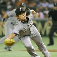 Helping himself: Hokkaido Nippon Ham starting pitcher Shugo Fujii snatches a line drive from the Giants' Shigeyuki Furuki in the fifth inning at Tokyo Dome on Wednesday night. | KYODO PHOTO