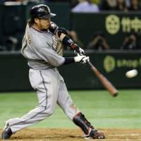 Big night: Hokkaido Nippon Ham Fighters third baseman Eiichi Yosano hits a single in the eighth inning to drive in his fourth RBI against the Yomiuri Giants on Wednesday at Tokyo Dome in Game 4 of the Japan Series. | KYODO PHOTO