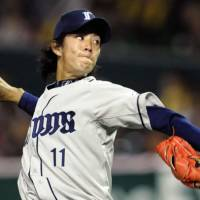Eye on the target: Saitama Seibu Lions hurler Takayuki Kishi prepares to make a pitch against the Fukuoka Softbank Hawks on Tuesday at Yahoo Dome in Fukuoka. Kishi tossed three scoreless innings in the Lions' 2-1 victory. | KYODO PHOTO