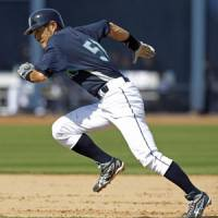 Sticky fingers: Ichiro Suzuki steals third during the Mariners spring training game against the Giants on Wednesday. | AP PHOTO