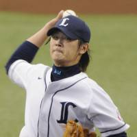 Strong start: Seibu ace Hideaki Wakui, the reigning Sawamura Award winner, allows one run and strikes out 10 batters in 7 2/3 innings, giving his club a big boost in its first game of the season. | KYODO PHOTO