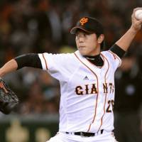 Winning form: Giants southpaw Tetsuya Utsumi fans 10 batters and holds the Swallows to four hits over eight innings on Friday at Tokyo Dome. Yomiuri beat Tokyo Yakult 4-1. | KYODO PHOTOS