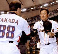 Opening day greetings: Giants manager Tatsunori Hara shakes hands with Swallows skipper Shigeru Takada prior to the start of Friday's game.