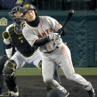 Big game hunter: Yomiuri's Hisayoshi Chono hits a three-run home run against the Tigers on Thursday. | KYODO PHOTO