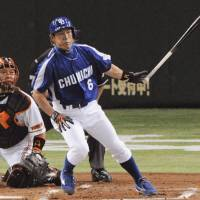 Hirokazu Ibata of the Dragons connects for an RBI double during the second inning of Friday's game against the Yomiuri Giants at Tokyo Dome. Chunichi won 7-4. | KYODO PHOTO