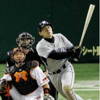 Clutch blast: Kodai Sakurai smacks a go-ahead, three-run home run in the eighth inning off Giants reliever Kiyoshi Toyoda on Tuesday at Tokyo Dome. Hanshin rallied for a 9-7 victory. | KYODO PHOTO