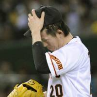 Look of frustration: Giants reliever Kiyoshi Toyoda reacts after giving up a three-run homer to Kodai Sakurai in the eighth inning on Tuesday. That gave Hanshin an 8-7 lead en route to a victory. | KYODO PHOTO