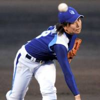 Historic shutout: Hyogo Swing Smileys right-hander Mika Konishi pitches a four-hitter against the Kyoto Asto Dreams on Friday in Kyoto. Hyogo defeated Kyoto 4-0 in the first game in Girls Professional Baseball League history. | KYODO PHOTO