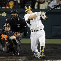 Giant killer: Hanshin's Kenji Johjima hits a three-run homer against the Giants on Sunday. | KYODO PHOTO