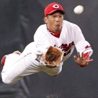 Falling short: Hiroshima Carp center fielder Soichiro Amaya fails to make a diving catch in the eighth inning against the Rakuten Golden Eagles during Friday's interleague game at Mazda Stadium. Rakuten won 8-7 in 10 innings. | KYODO PHOTO