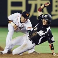 Caught in the act: Chiba Lotte's Tsuyoshi Nishioka fails to steal second base against the Giants on Saturday. | KYODO PHOTO